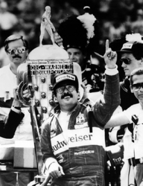 Photo of Bobby Rahal holding a trophy