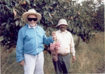 Photo of Mohammad Abdalla wearing the straw hat in the fields